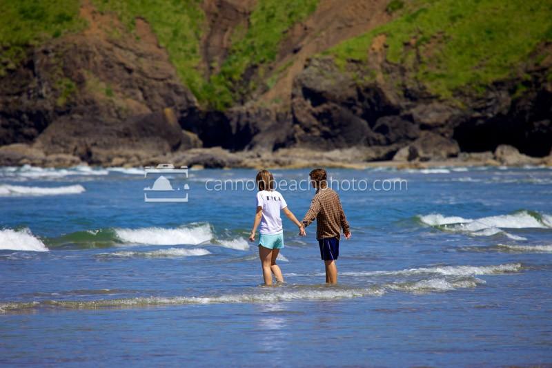 Beach Couple Holding Hands