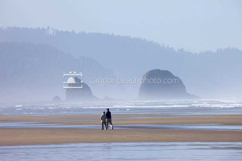Couple Strolling the Beach Mid-Morning