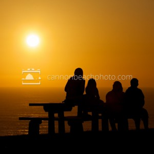 Beach Family Enjoying Sunset