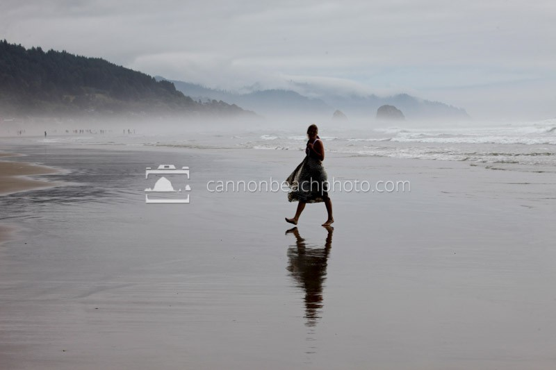 A Woman Strolls the Afternoon Shore