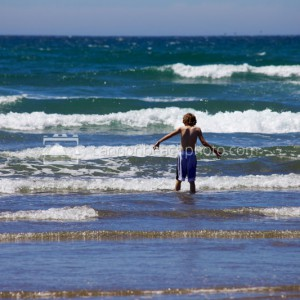 Child Playing at the Ocean Shore