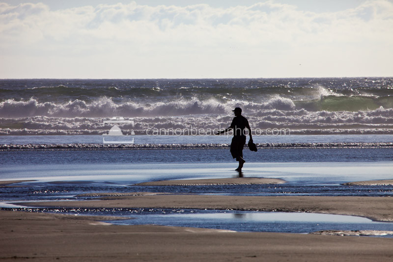 Silhouetted Man Gesturing on the Shoreline