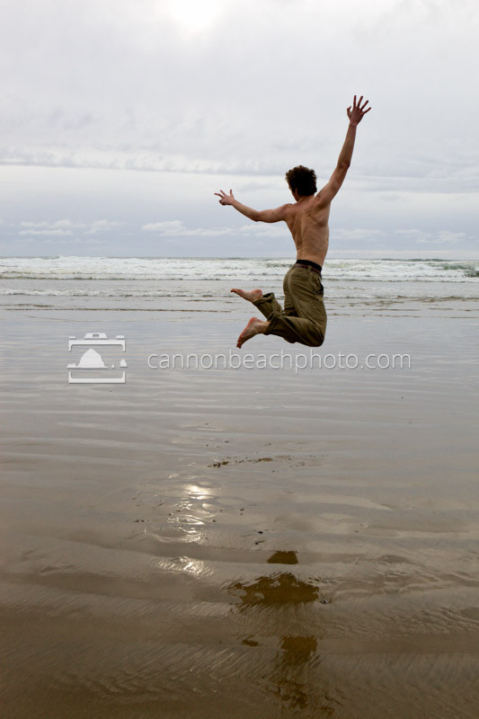 A man leaps for joy and play at Arcadia Beach near Cannon Beach, Oregon.  Also see this image as a poster: http://smu.gs/zxQVRy