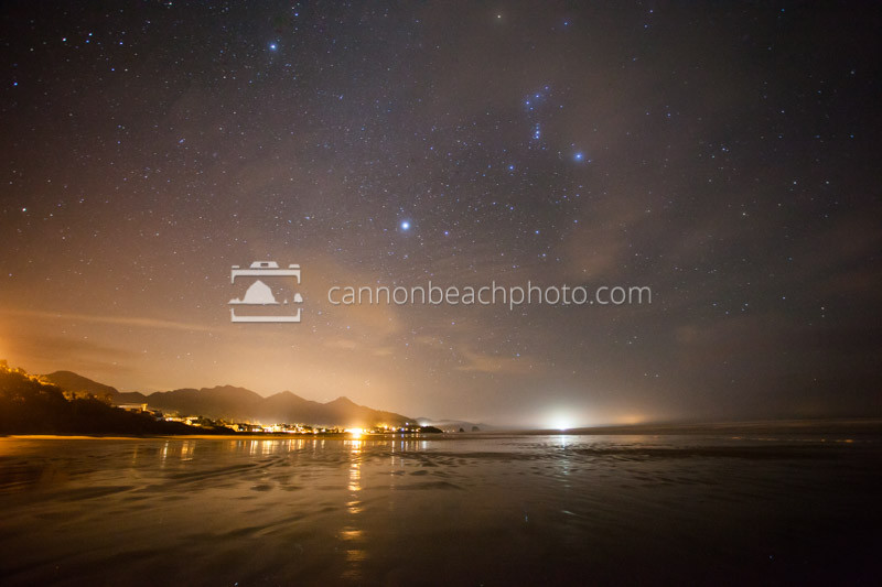 The stars burn brightly above the reflective sands of Cannon Beach.