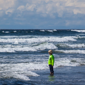 Child Standing in Surf