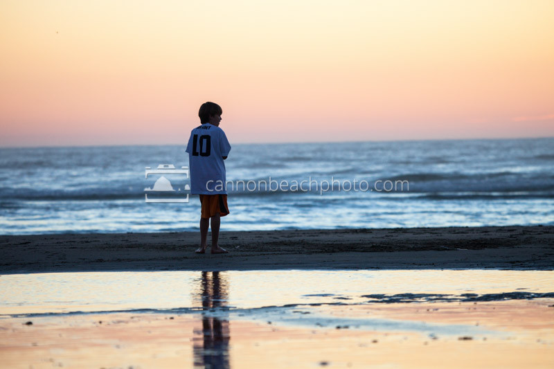 Child Standing on Sunset Seashore