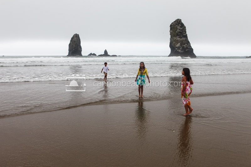 Children Play in the Surf at the Needles