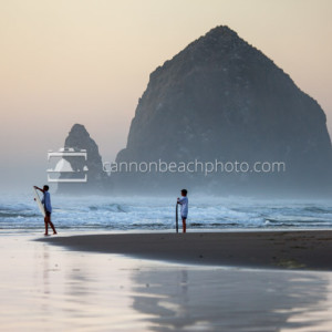 Children Skimboarding with Haystack Rock