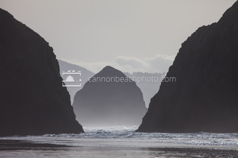 The iconic Haystack Rock stands in the distance in the Gap between Murre Rocks on the North Oregon Coast.