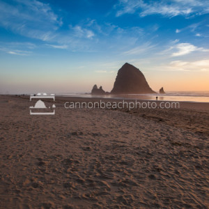 Haystack Rock at Sunset with Sand Foreground