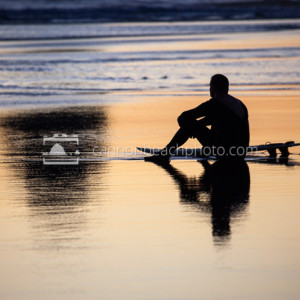 Surfer Sits Serene at Sunset
