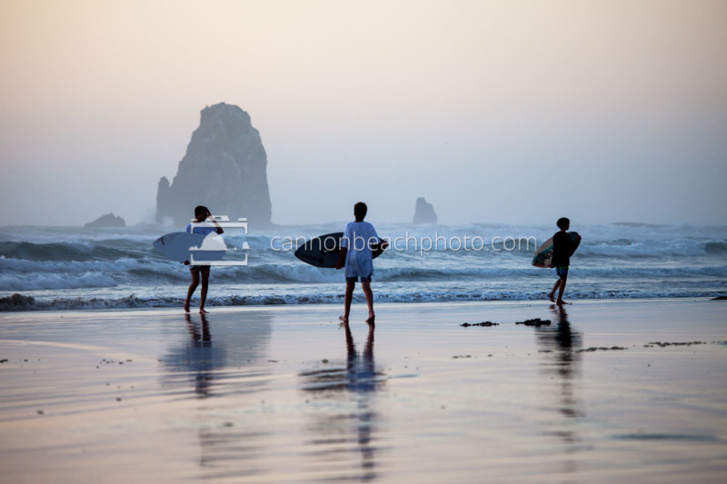 Three Kids Skimboarding Evening in Cannon Beach, Oregon