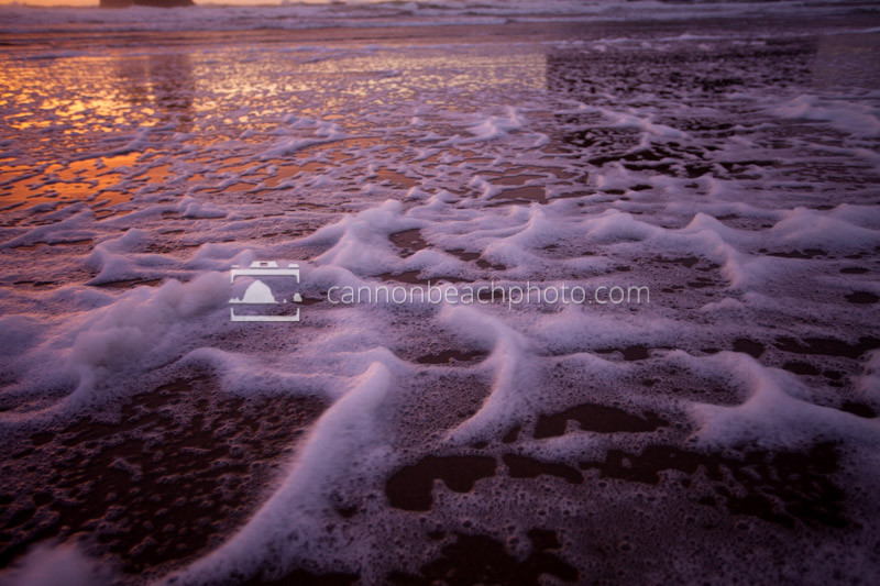 Beach Foam at Stormy Sunset