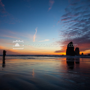 Woman Captures Sunset in Cannon Beach