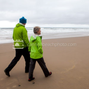 Couple Walking the Shoreline, Oregon Coast