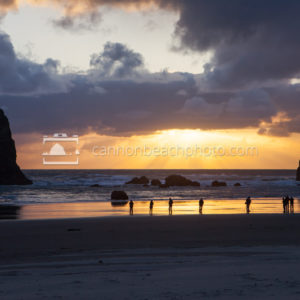 Group of People Watching Sunset at Haystack Rock