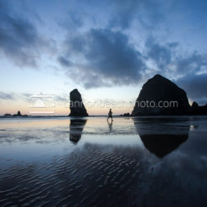 Haystack Rock and Skimboarder Heading In