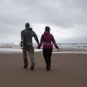 Young Couple Enjoying Beach Walk