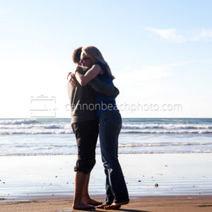 Couple Hugging on Edge of the Ocean