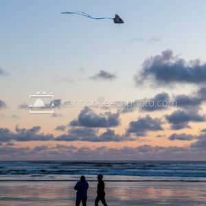 Couple Flying Kite at Sunset 3