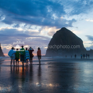 Family Watching Sunset at Haystack Rock, Dramatic Sky
