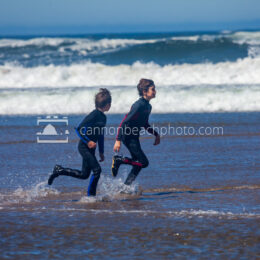 Kids Running thru the Water