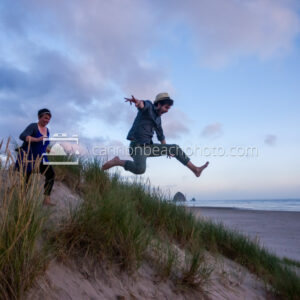 Couple Dune Jumping in Cannon Beach