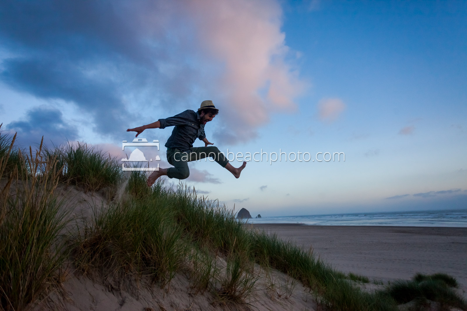 Man Dune Jumping Over Haystack