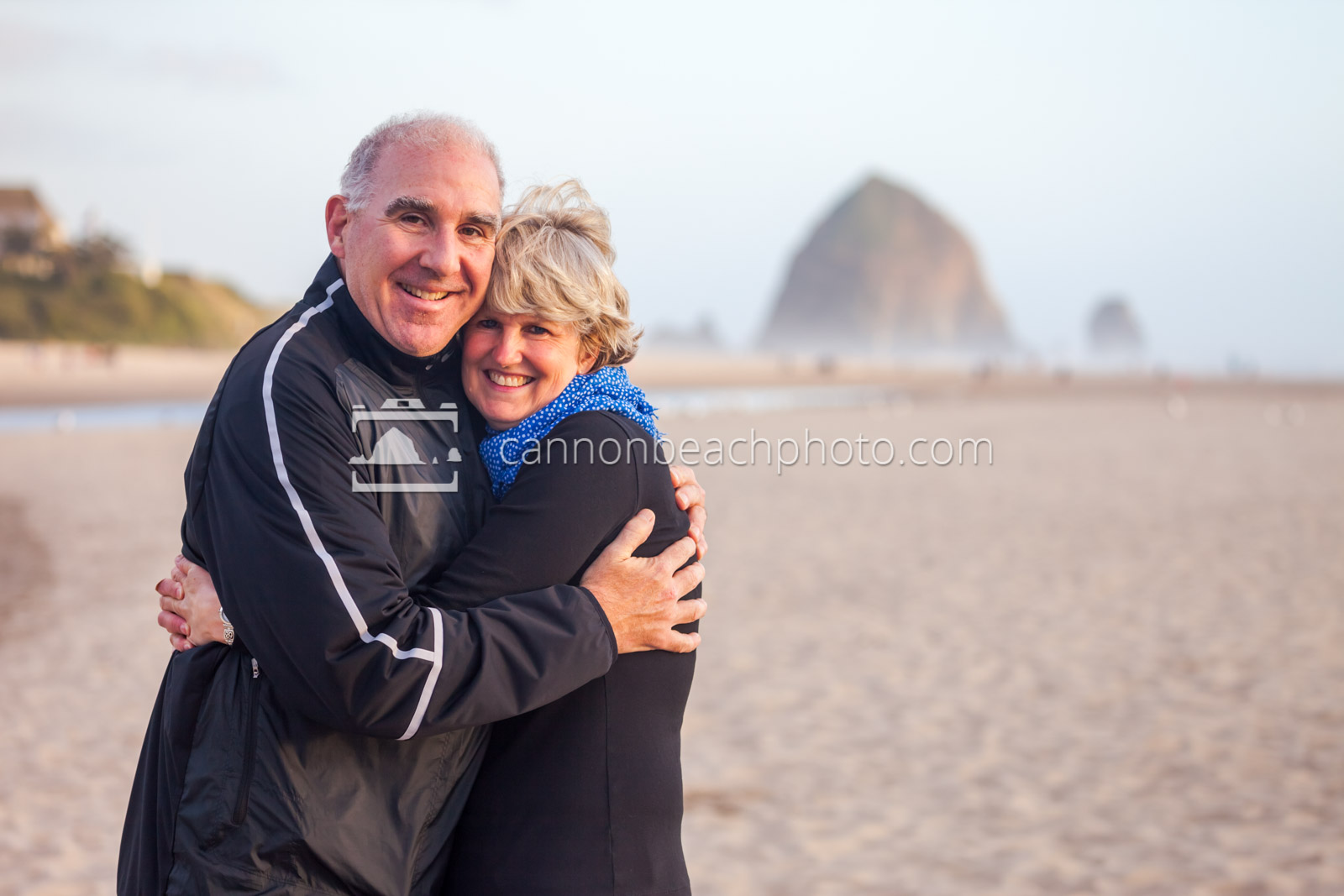 Middle Aged Couple Smiling on the Beach