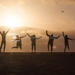 Silhouetted Family Jumping on the Beach 1