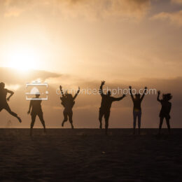 Silhouetted Family Jumping on the Beach 2