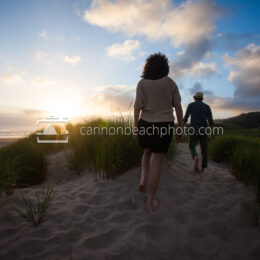 Two People Walking thru the Sunset Dunes