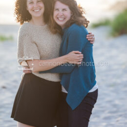 Two Sisters Grinning on the Beach