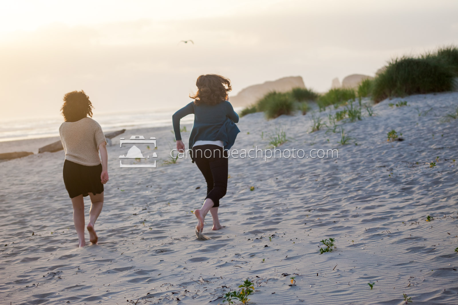 Two Young Women Running on the Beach