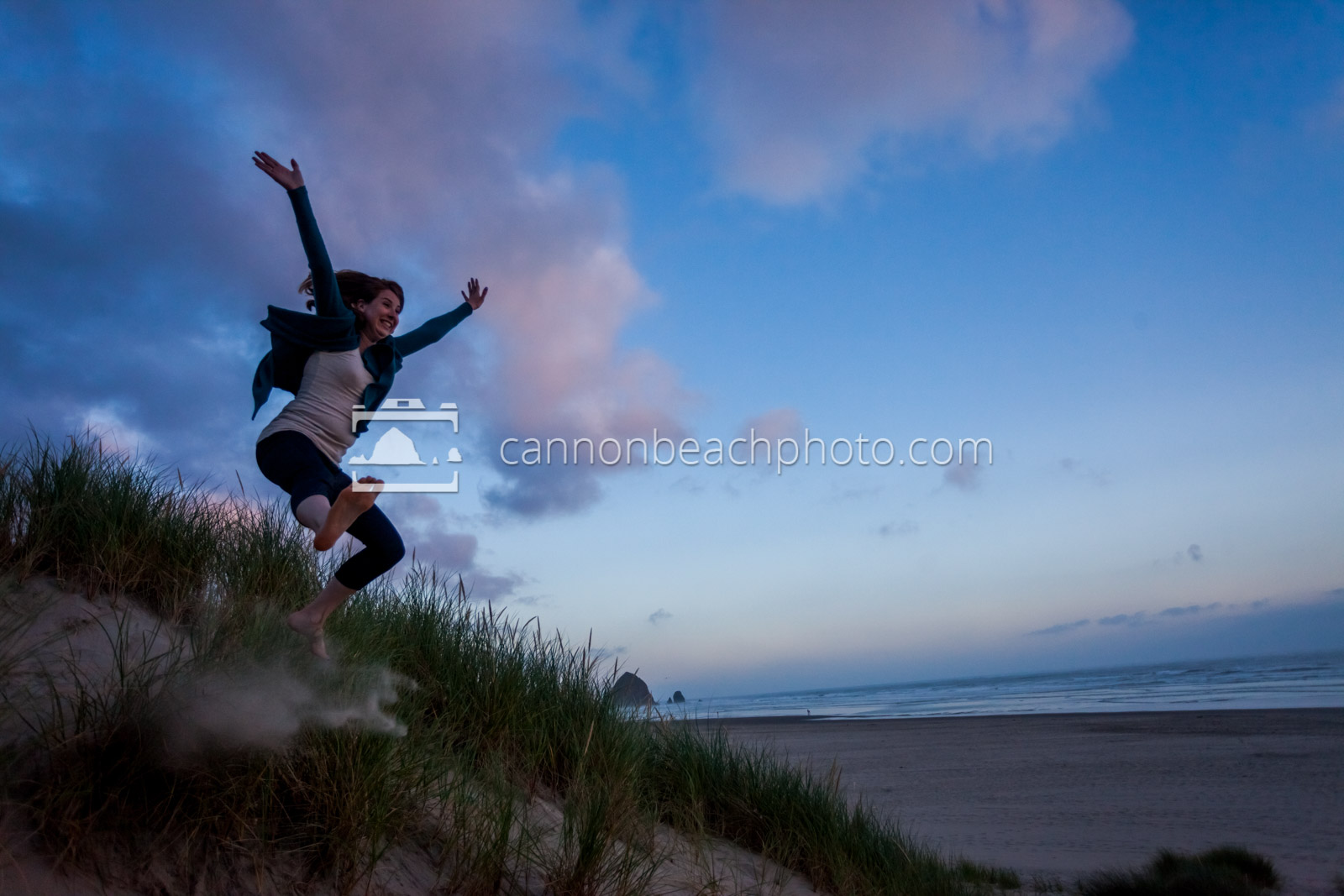 Woman Dune Jumping at Sunset