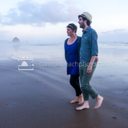 Young Couple Walking on the Evening Sand