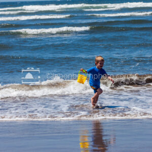 Boy Playing at the Ocean