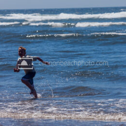 Boy Running in the Ocean