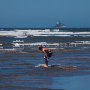 Boy Skimboarding, Tillamook Lighthouse