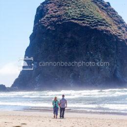 Couple Walking Near Haystack Rock