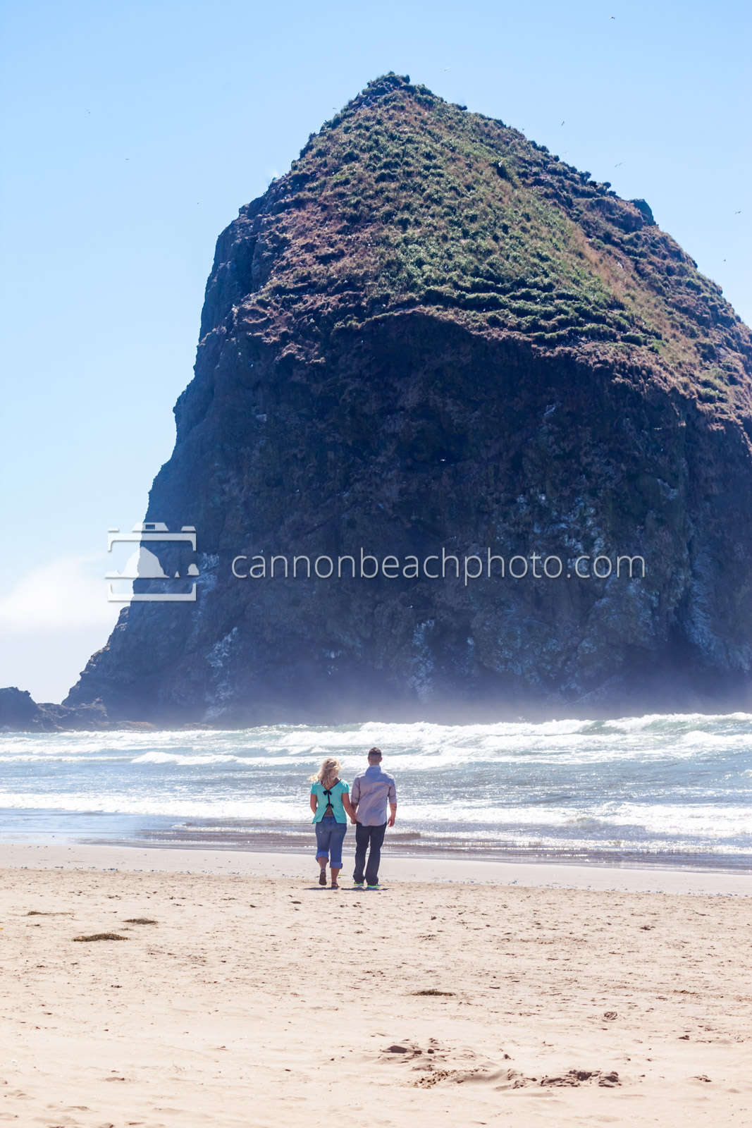 Couple Walking Near Haystack Rock