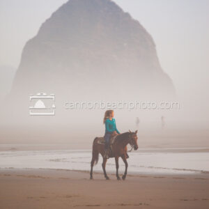 Woman Riding Horseback on a Foggy Day Near Haystack Rock 1