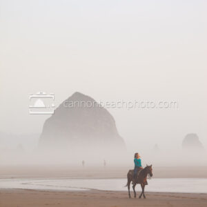 Woman Riding Horseback on a Foggy Day Near Haystack Rock 2