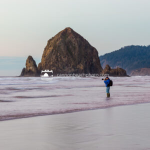 Photographer with Haystack Rock near Sunset