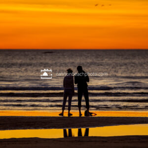 Silhouetted Couple in Yellow Sunset, Vertical