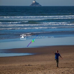 Man Flying a Kite in Cannon Beach